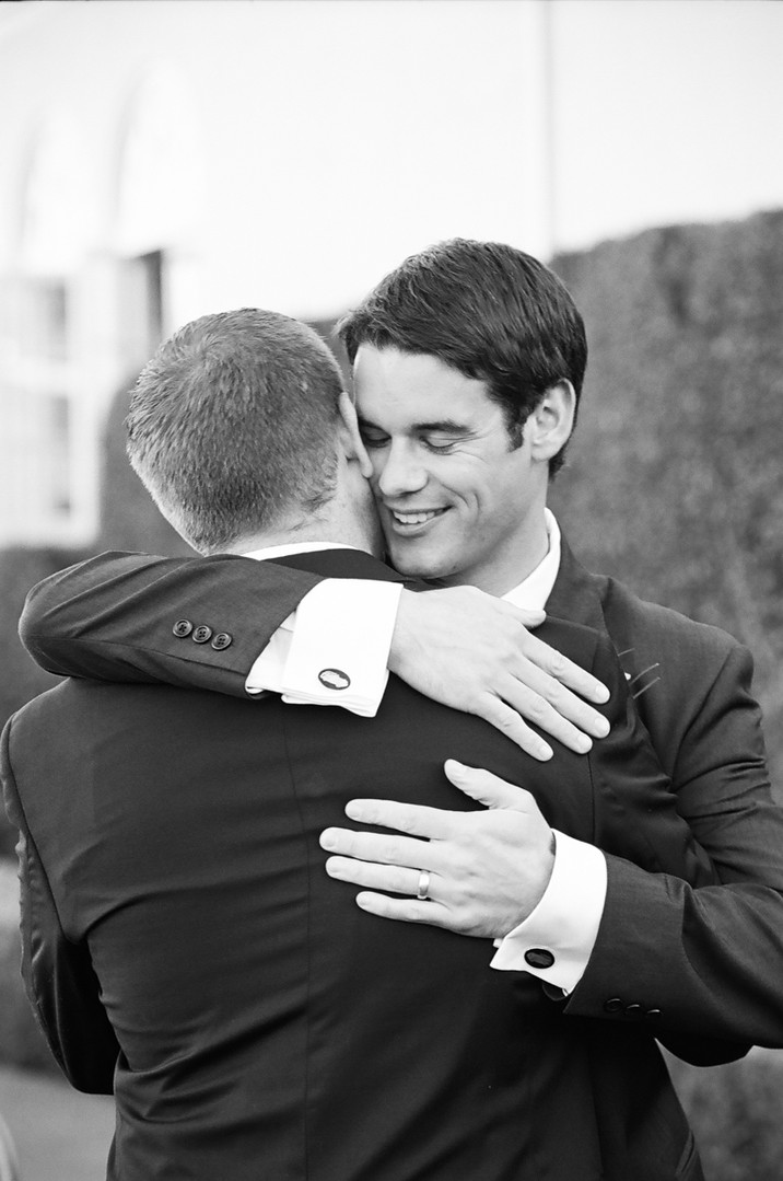 Tiburon Wedding Groomsmen Hug