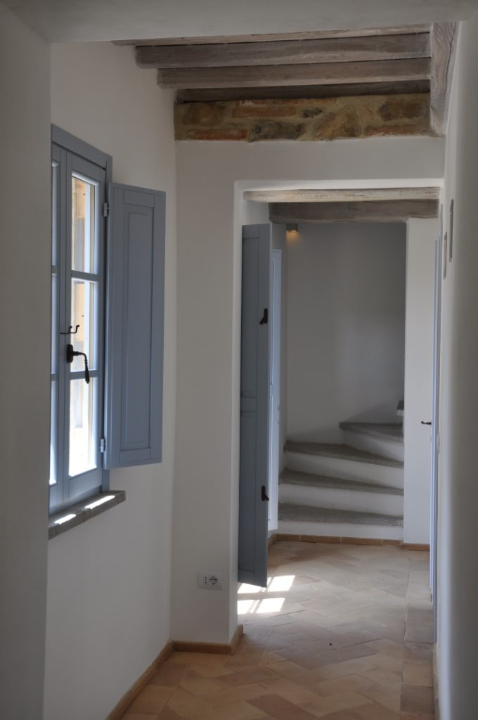 light hallways leading to the rooms