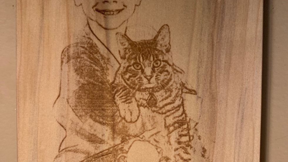 Laser engraved Child portraits on wood