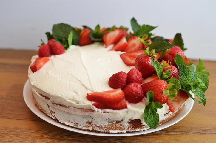 Easy Yogurt Cake topped with Whipped Cream & Berries