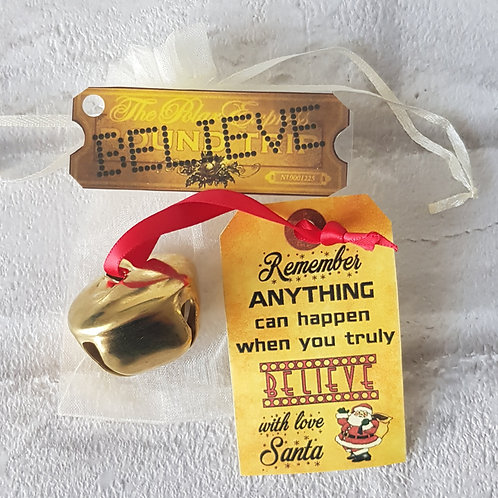 I believe polar express style large metal jingle bell & ticket Christmas GOLD