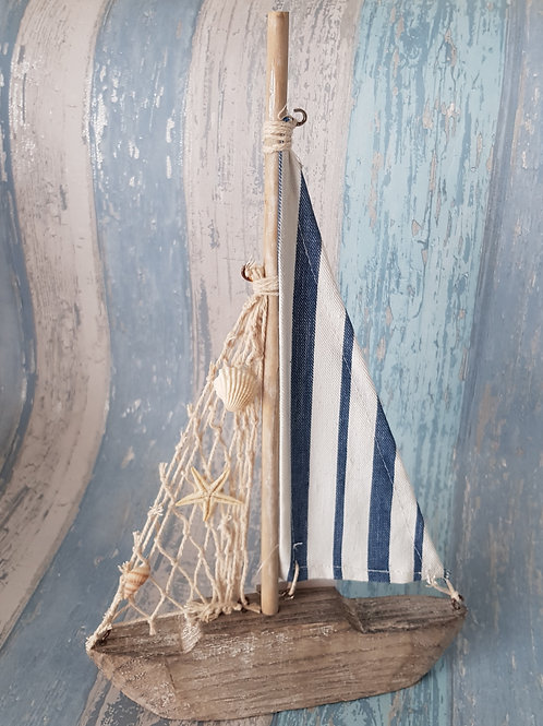 Wooden yacht with fishing net sail