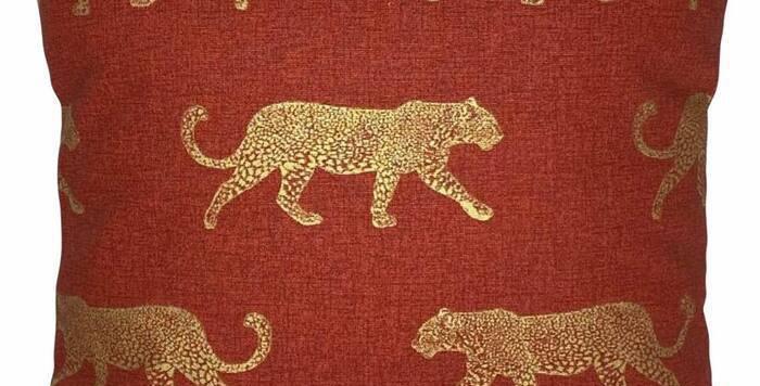Leopard print cushion cover - metallic gold leopards on terracotta