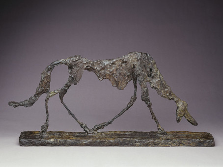 This bronze dog represents the artist who made it. Guess who!
