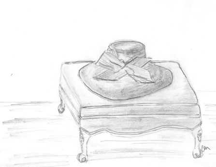 hat on french ottoman clare .JPG
