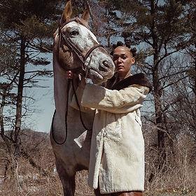 Same coat worn by _kokeadile in a fashio