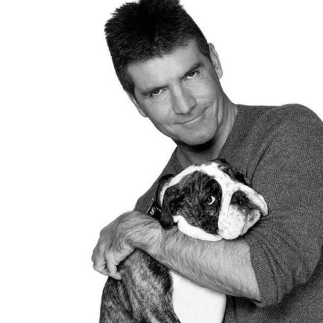 Simon Cowell with a bulldog puppy