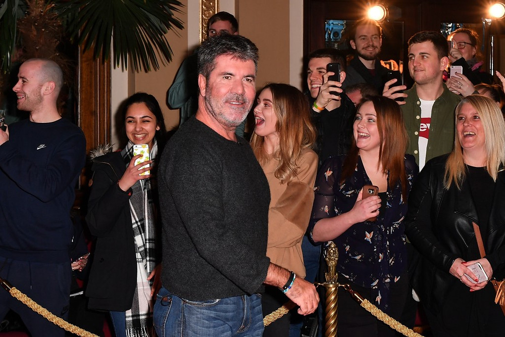 Simon Cowell with fans at a Britain's Got Talent audition