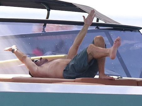 Simon Cowell works out on a yacht in Barbados