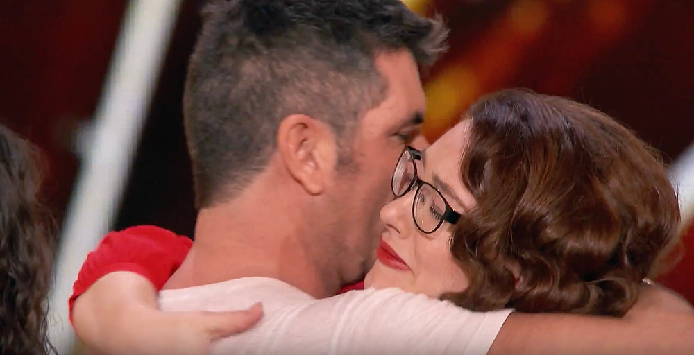 Simon Cowell and Mandy Harvey hug on America's Got Talent