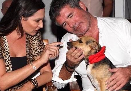 Simon Cowell donates US $250,000 to K9 Friends dog charity.