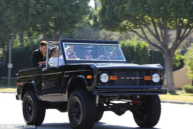 Simon Cowell with Prettymuch boyband in his Bronco jeep