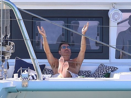 Simon Cowell continues to enjoy his holiday in Barbados on a catamaran