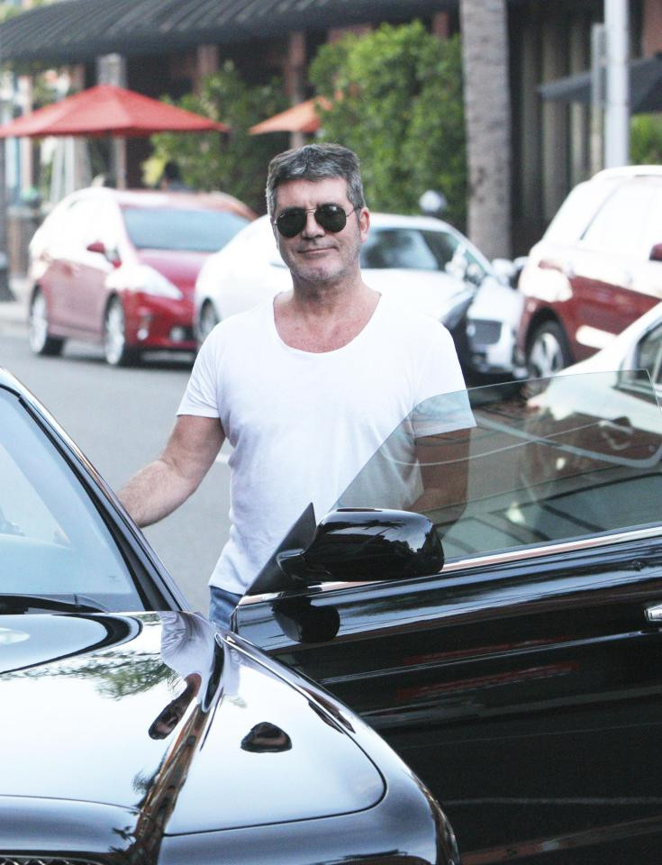 Simon Cowell with his Bentley in Beverly Hills