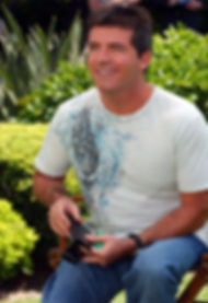 Simon Cowell in his 30's wearing a patterned t shirt