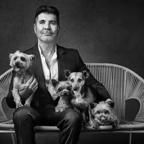 Simon Cowell with his dogs in a celebrity photo shoot for Guide Dogs for the Blind