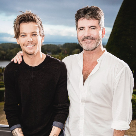 Simon Cowell and Louis Tomlinson