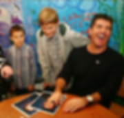 simon cowell with the children of Chase Childrens hospice