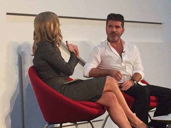 Simon Cowell with Gaby Roslin at the GIC conference in London