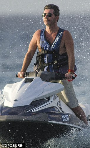 Simon Cowell on Jet Ski in Barbados