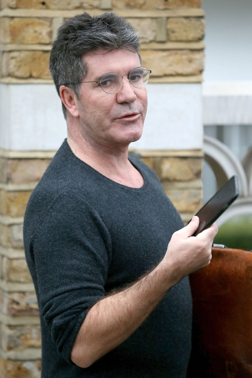 Simon Cowell outside his London home