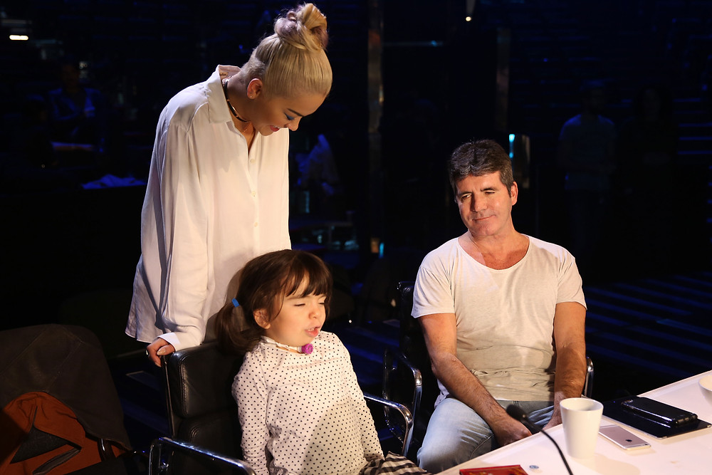 Simon Cowell with children from the Chase Hospice
