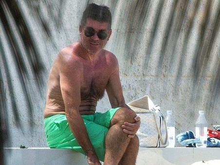 Simon Cowell takes his family on a summer break to Barbados