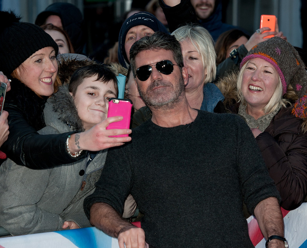 Simon Cowell with fans at Britain's Got Talent