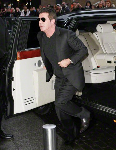 Simon Cowell emerging from his Rolls Royce in Manchester