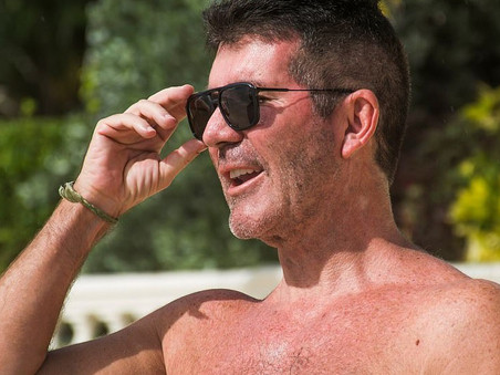 Simon Cowell and Eric start their Christmas vacation on the beach in Barbados