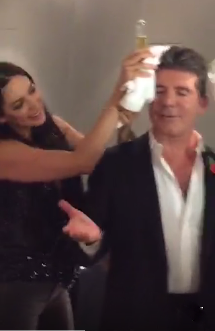 Simon Cowell receiving an ice pack to his head after X Factor