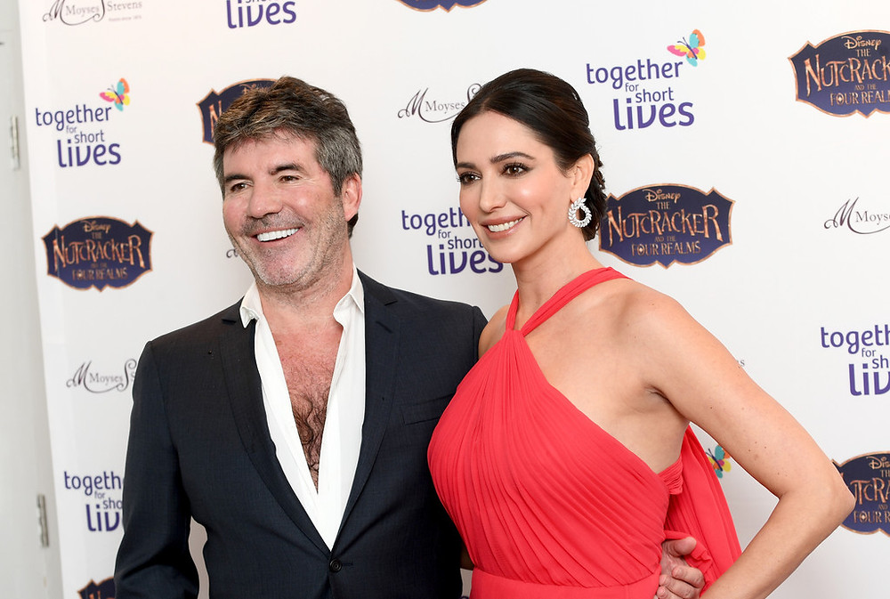Simon Cowell and Lauren Silverman at the Together for Short Lives ball in London