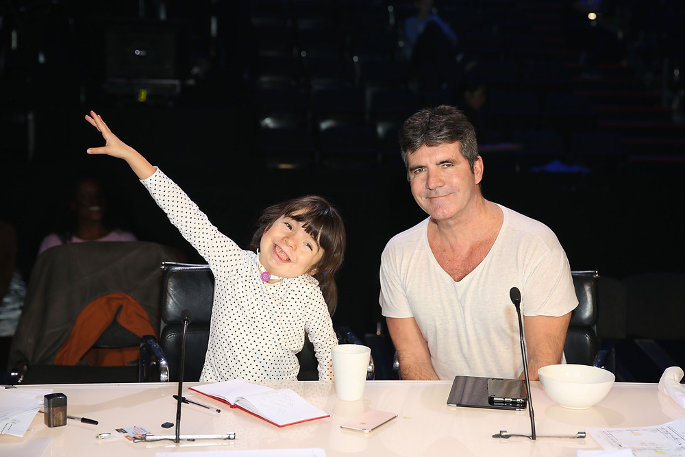 Simon Cowell with the children of Chase hospice