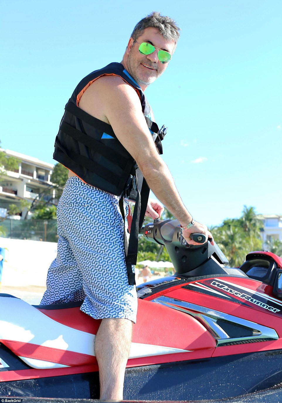 Simon Cowell on a jet-ski in Barbados