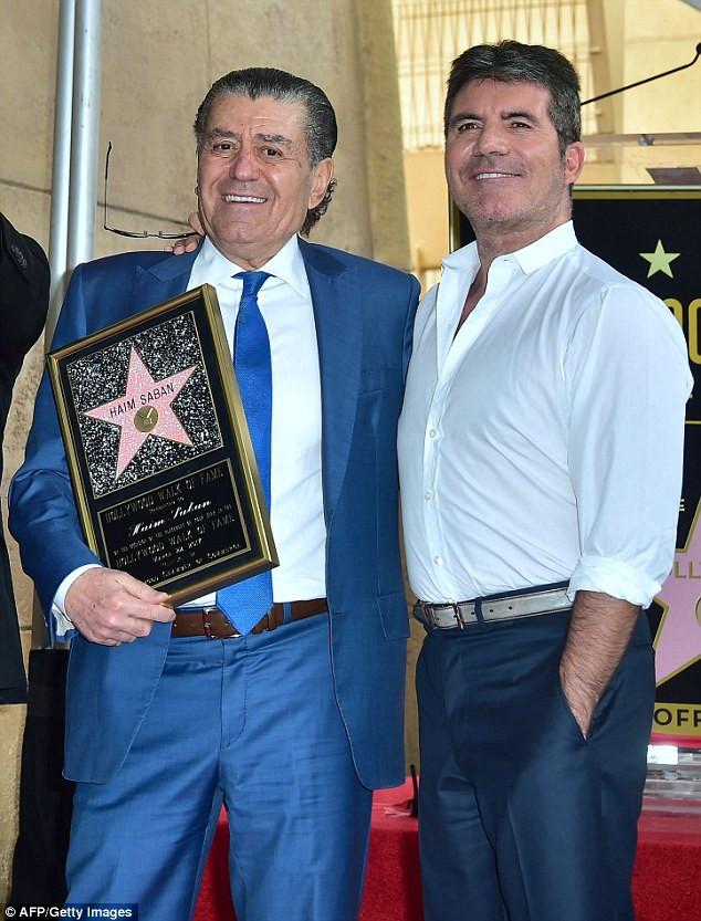 Simon Cowell and Haim Saban at Hollywood Walk of Fame