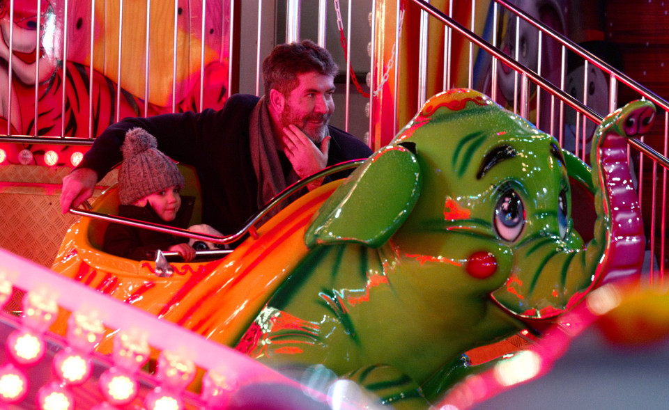 Simon Cowell on a ride with Eric at Winter Wonderland