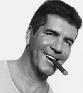 simon cowell smoking a cigar