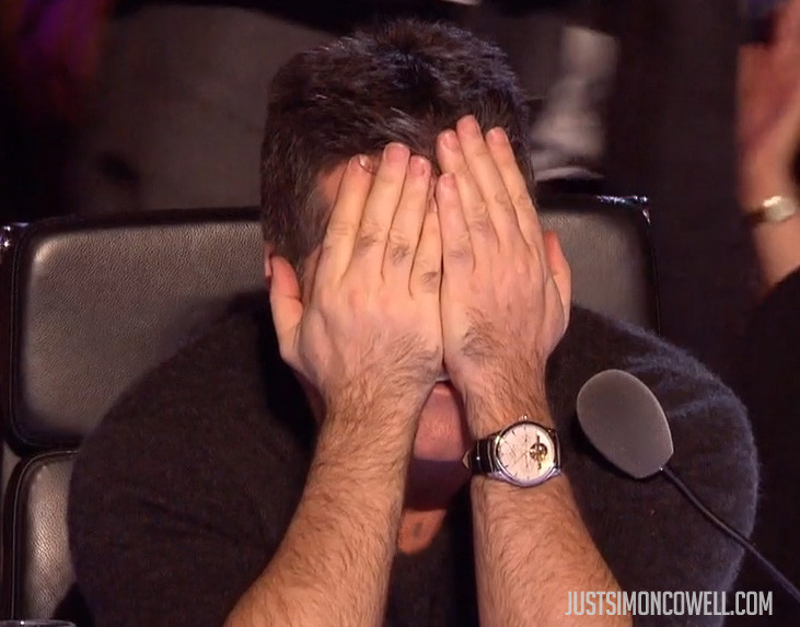 Simon Cowell head in hands