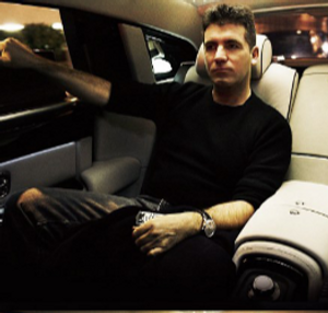 simon cowell sitting in his Rolls Royce car