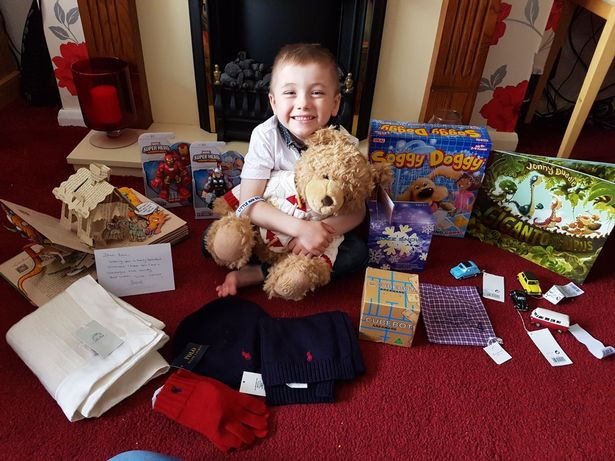 Kian Musgrove with the gifts from Simon Cowell