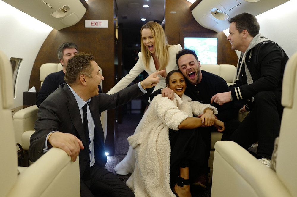 Simon Cowell and the Britain's Got Talent judges on a private jet