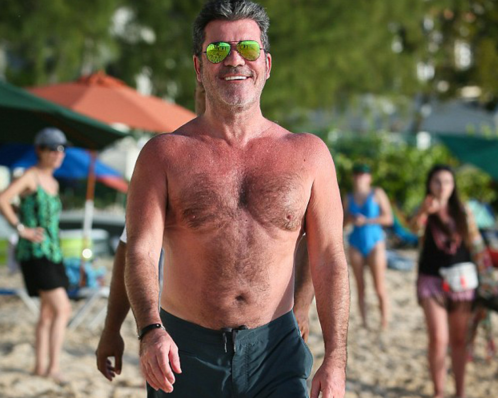 Simon Cowell on the beach in Barbados