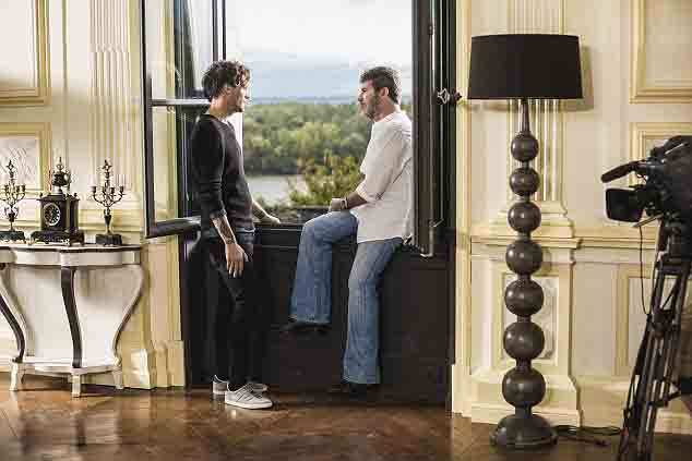 Simon Cowell and Louis Tomlinson