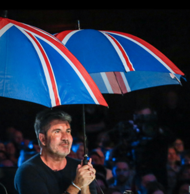 Simon Cowell holding an umbrella at the Britain's Got Talent auditions