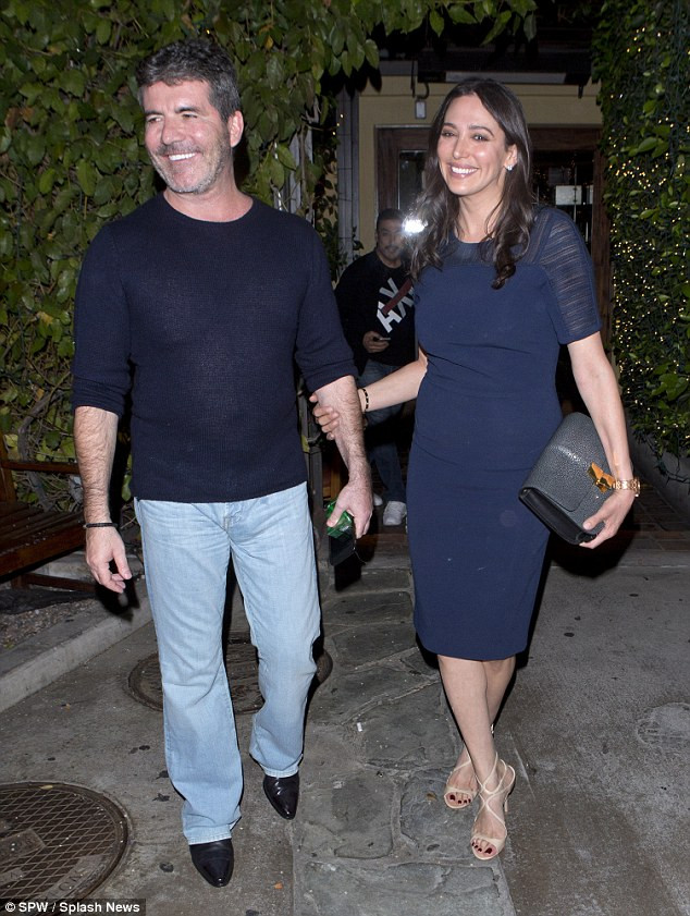 Simon Cowell and Lauren Silverman at Ago Hollywood