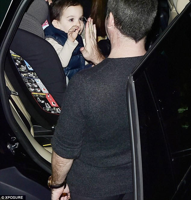 Simon Cowell shares a high five with son Eric