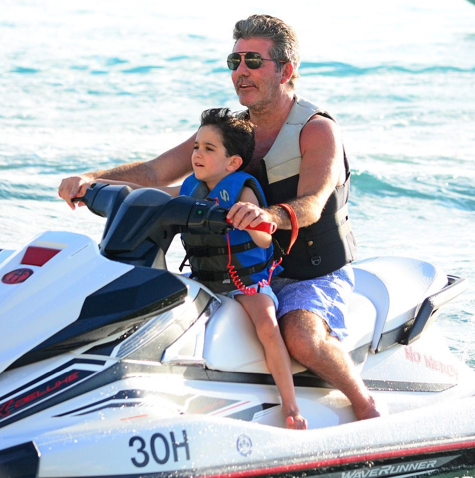 Simon Cowell and his son Eric jet-skiing in Barbados last year.