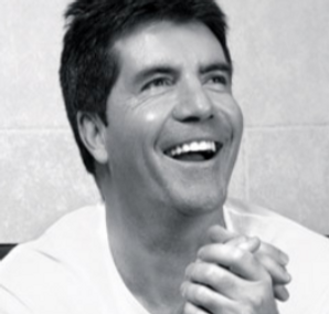 simon cowell laughing in a black and white retro photograph