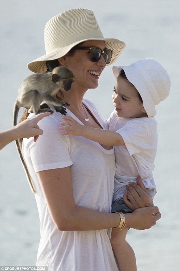 Lauren Silverman with Simon Cowell's son Eric in Barbados
