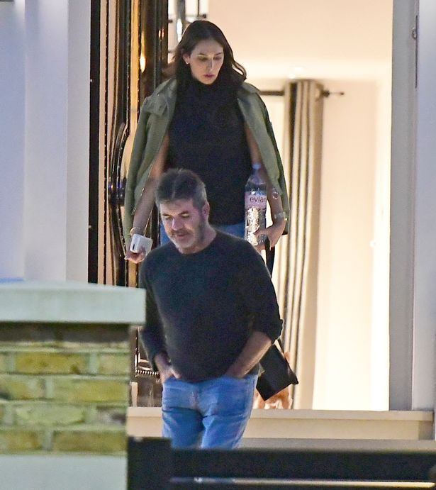 Simon Cowell with Lauren Silverman leaving his London house